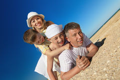 Family lying on sand Royalty Free Stock Images