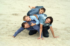 Family lying on the sand Stock Photo