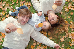 Family lying and showing autumn leaves. Top view Stock Image