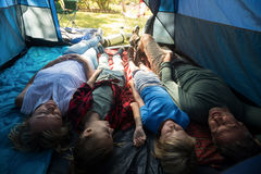Family lying in the tent Stock Images