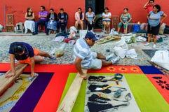 Family make Good Friday carpet, Antigua, Guatemala. Antigua, Guatemala -  April 3, 2015: Local family make Good Friday processional carpet (alfombra) using Royalty Free Stock Photo