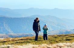 Family make photo on autumn  mountain plateau. Family (mother with son) walk and make photo on autumn mountain plateau Stock Photos