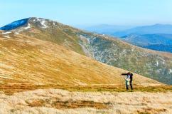 Family make photo on autumn  mountain plateau Royalty Free Stock Photos