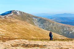 Family make photo on autumn  mountain plateau Stock Images