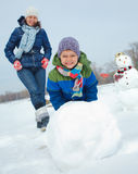 Family make a snowman Royalty Free Stock Photos