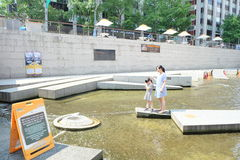 Family make a wish for lucky at Cheonggyecheon Stream, South Korea. Cheonggyecheon is an 11 km long modern stream that runs through downtown Seoul. Created as Royalty Free Stock Photos