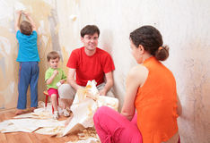 Family makes interruption in removal of wallpa royalty free stock photography