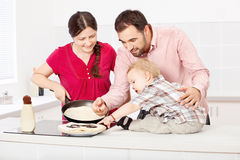 Family makes pancakes in the kitchen Stock Images