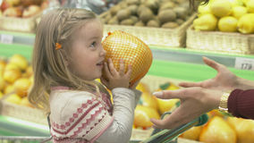 Family makes purchases in the supermarket stock images
