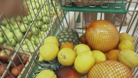 Family makes purchases in the supermarket royalty free stock photography