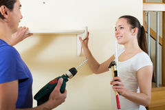Family makes repairs at home Stock Images