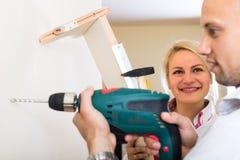 Family makes repairs at home Royalty Free Stock Photos