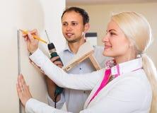 Family makes repairs at home Royalty Free Stock Image