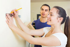 Family makes repairs at home Stock Image