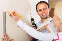 Family makes repairs at home Stock Photo