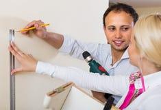 Family makes repairs at home Royalty Free Stock Photo
