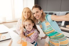 Family makes selfies for Thanksgiving in the kitchen while cooking food Royalty Free Stock Photos