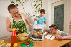 The family makes a supper. Royalty Free Stock Images