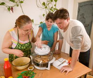 The family makes a supper. Stock Images