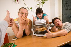 The family makes a supper. Stock Photos