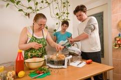 The family makes a supper. Stock Photos