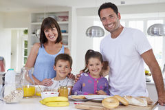 Family Making Breakfast In Kitchen Together Royalty Free Stock Photo