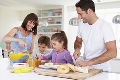 Family Making Breakfast In Kitchen Together Royalty Free Stock Photography