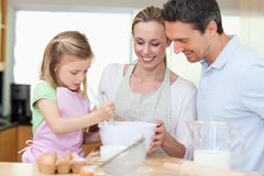 Family making cookies. Together in the kitchen royalty free stock photos