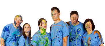 Family making faces after a paint fight Stock Images