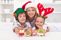 Family making gingerbread cookie people Royalty Free Stock Photography