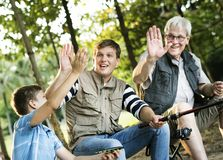Family making a high five while fishing royalty free stock photos