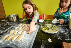 Family is making home made pastry dumplings tortellini or raviol Royalty Free Stock Photography