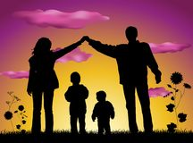 Family making house silhouette stock photo