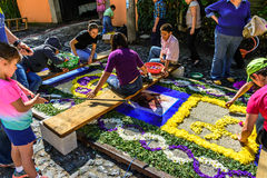 Family making Lent carpet, Antigua, Guatemala Royalty Free Stock Images