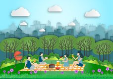 Family making picnic on city park outdoor. Dad,mom,son and daugh. Ter are resting in nature. the park was built on the outskirts. in spring flowers season Stock Image