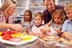 Family making pizza for dinner Royalty Free Stock Images
