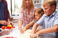 Family making pizza together Stock Photos
