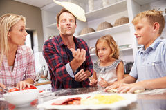 Family making pizza together Stock Photo