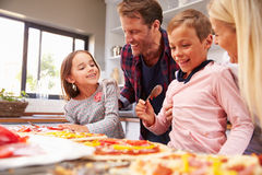 Family making pizza together Royalty Free Stock Image