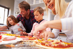 Family making pizza together Stock Photography