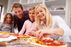 Family making pizza together Royalty Free Stock Photography