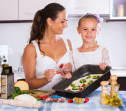 Family making pizza with vegetables Royalty Free Stock Photography