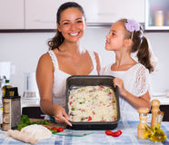 Family making pizza with vegetables Royalty Free Stock Photos