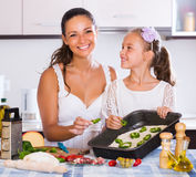 Family making pizza with vegetables Royalty Free Stock Image
