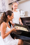 Family making pizza with vegetables Stock Image