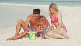 Family Making Sandcastle On Beach Holiday stock video footage