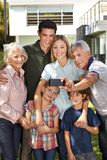 Family makes selfie with grandparents. Family is making selfie with grandparents and children in the garden royalty free stock photo