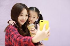 Family making selfie , Smiling happy arab egyptian mother with daughter taking selfie Stock Images