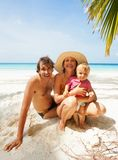 Family on Maldivian beach Stock Photos