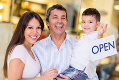 Family holding an open sign Royalty Free Stock Images